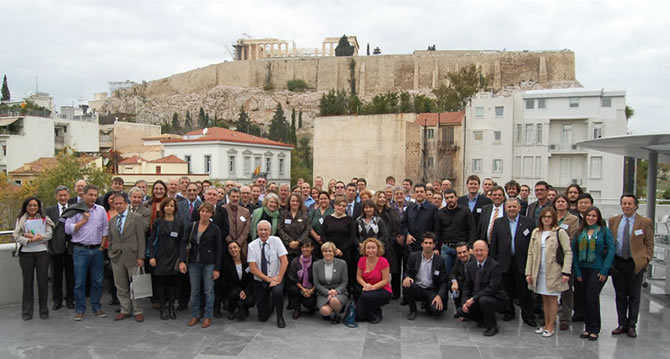 The delegates outside the Acropolis Museum Conference Centre, the Parthenon in the background